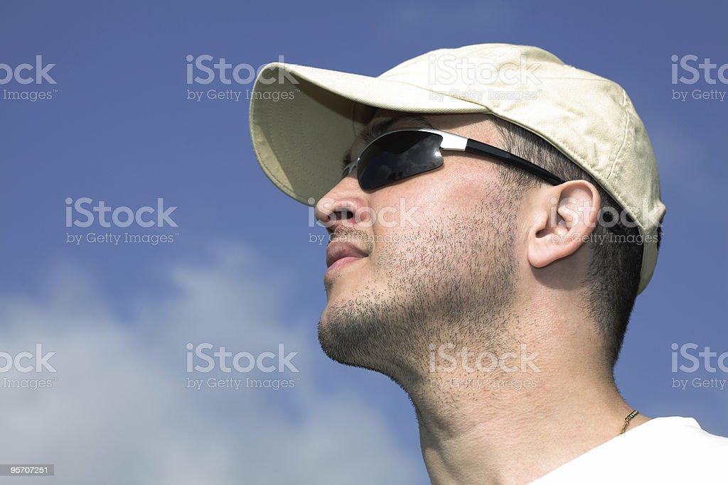 Young man over sky background stock photo