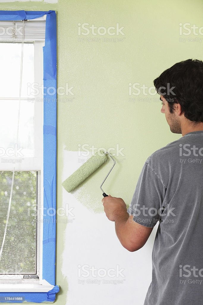 Young Man Painting Around Window Frame royalty-free stock photo