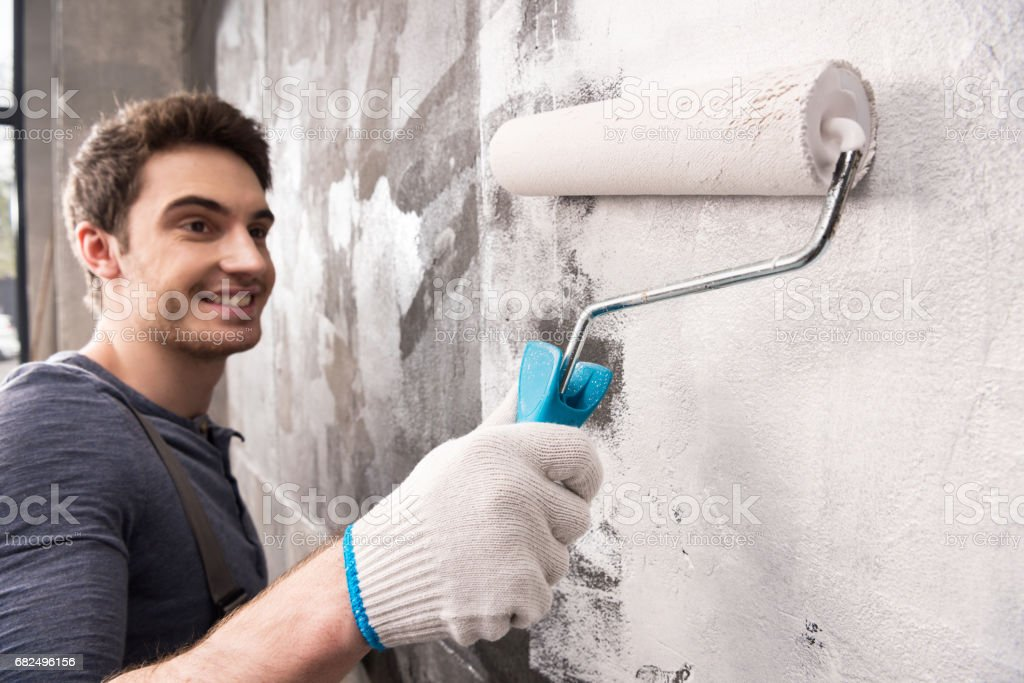 young man painting wall, renovation home concept royalty-free stock photo