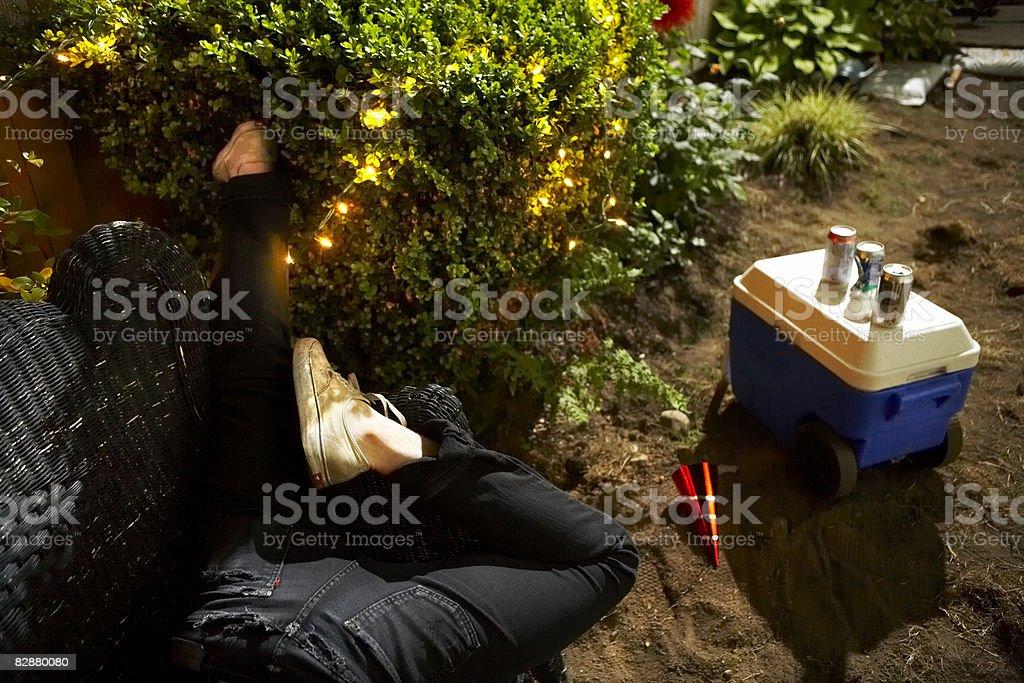 Young man passed out at backyard party royaltyfri bildbanksbilder
