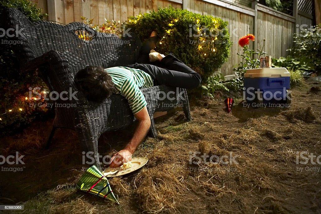 Young man passed out at party royaltyfri bildbanksbilder