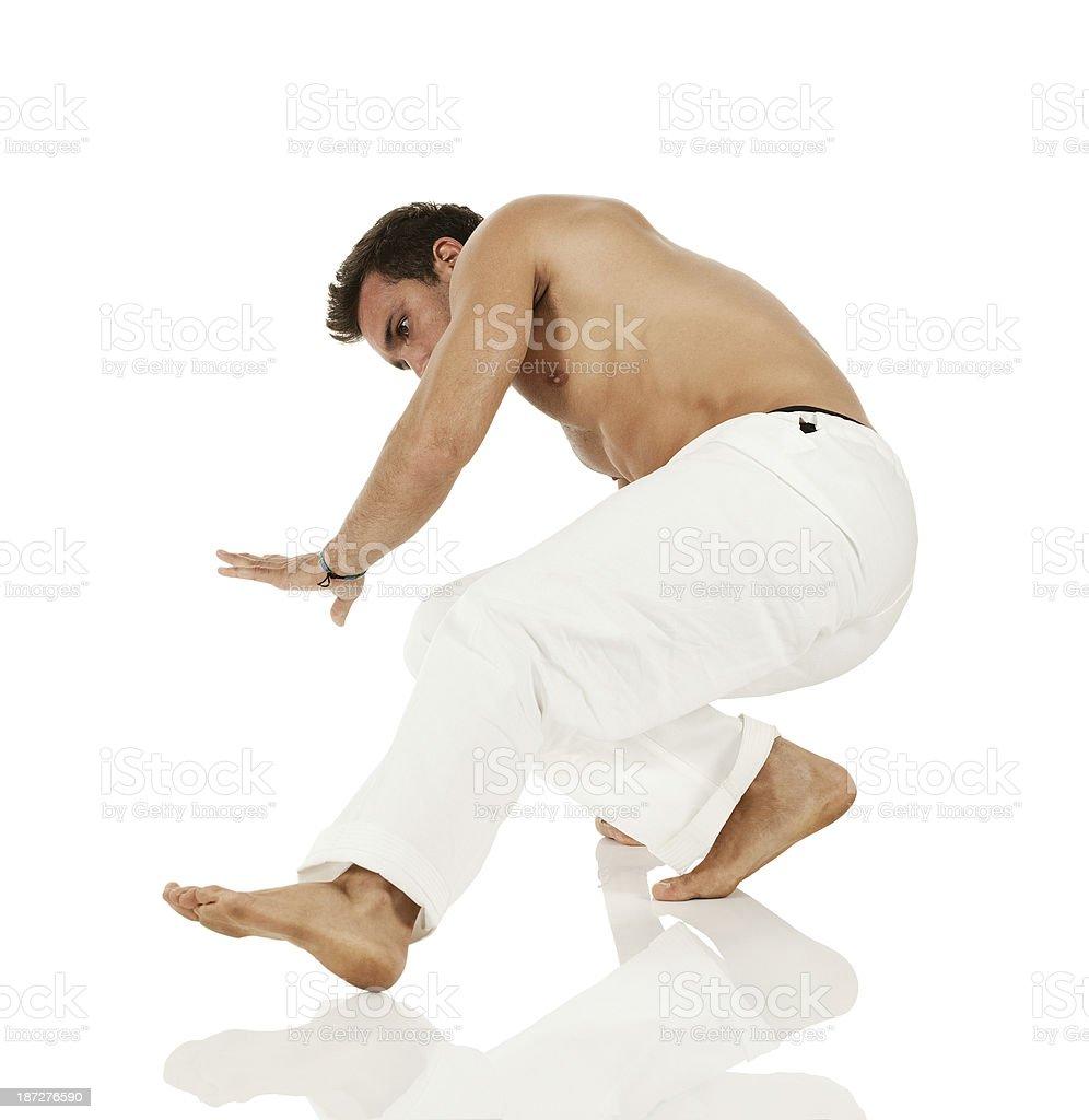 Young man performing cartwheel royalty-free stock photo