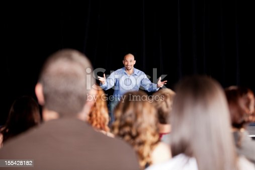 istock Young man performing on stage for an audience 155428182