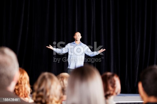 istock Young man performing on stage for an audience 155428481
