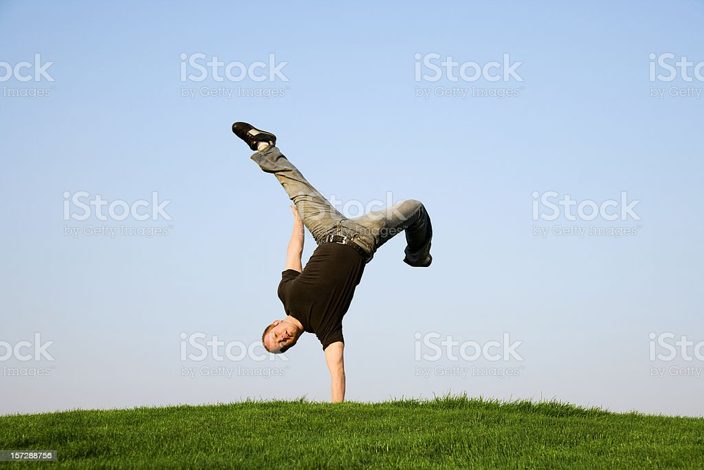 Young Man Performing One-armed Hand Stand royalty-free stock photo