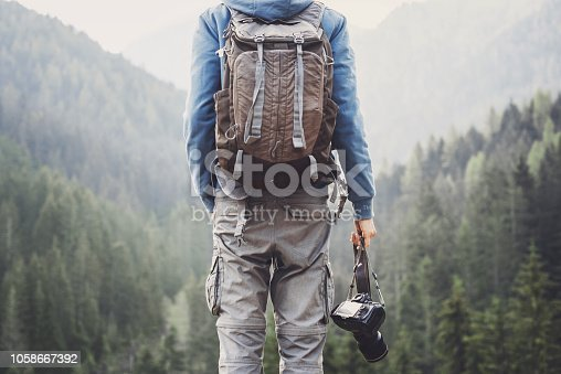 Men taking pictures with DSLR Camera. Photographer shooting in a mountains