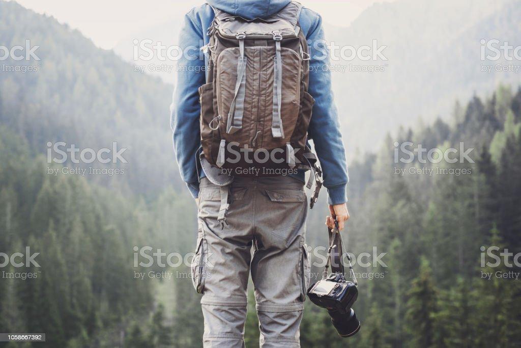 Young man photographer holding photo camera stock photo