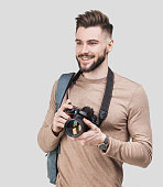 Handsome men photographer is taking pictures with dslr camera