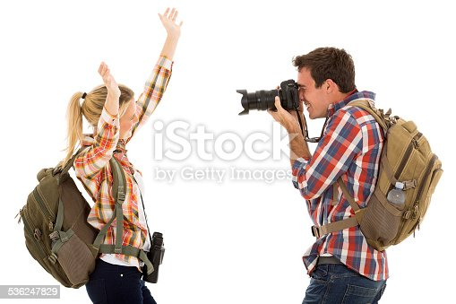 926982852 istock photo young man photographing his girlfriend 536247829