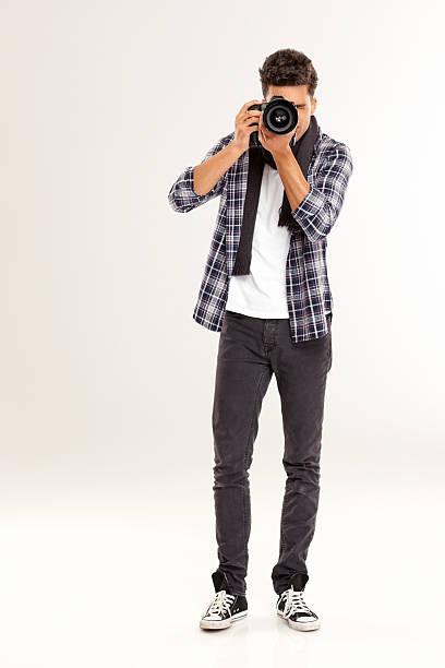 Young man photographing with a digital camera picture id181100026?b=1&k=6&m=181100026&s=612x612&w=0&h=xxqongerlskf j7oro0qrrhtbiieaina9jwqbyycfjy=