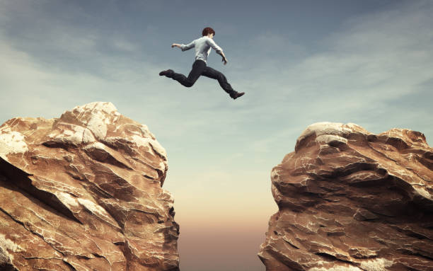 Young man Young man jumping over the chasm. This is a 3d render illustration ravine stock pictures, royalty-free photos & images