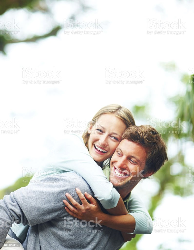 Young man piggybacking his wife royalty-free stock photo
