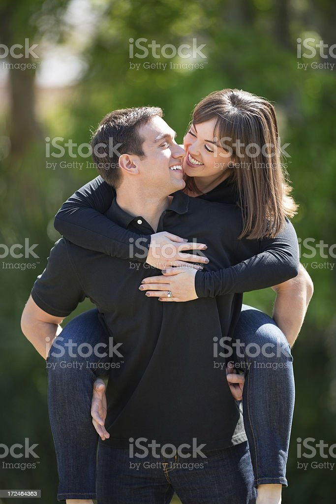Young Man Piggybacking Woman At Park royalty-free stock photo