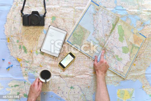 istock Young man planning a road trip 487081189