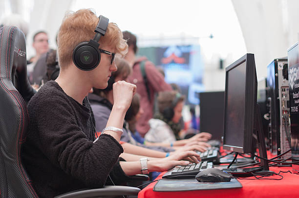 Young man play game on personal computer at Animefest stock photo