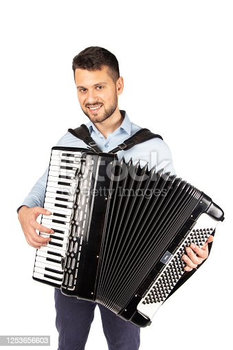 Young man playing accordion, isolated on white background