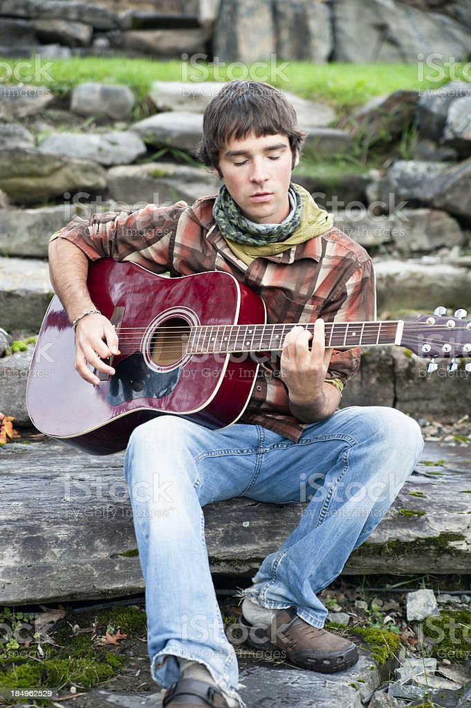 Young man playing acoustic guitar. royalty-free stock photo