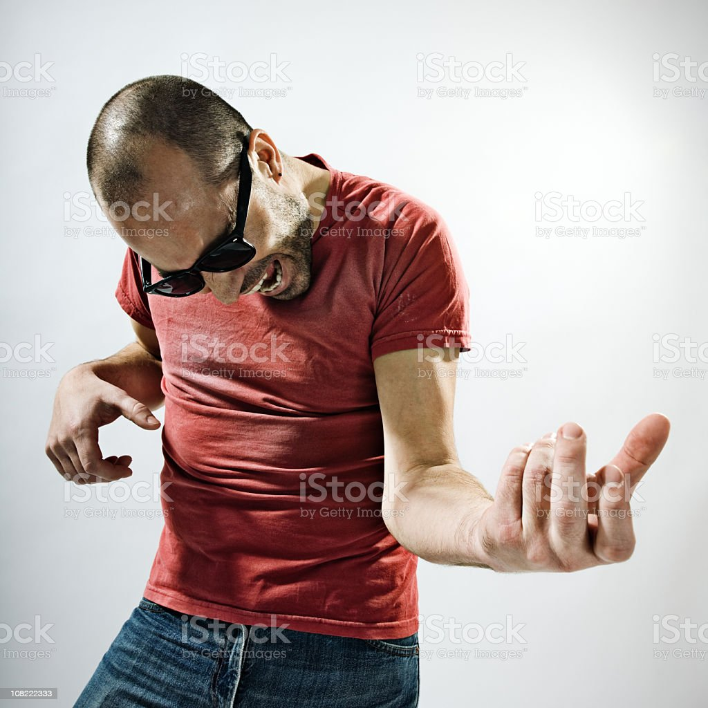 Young man playing air guitar stock photo
