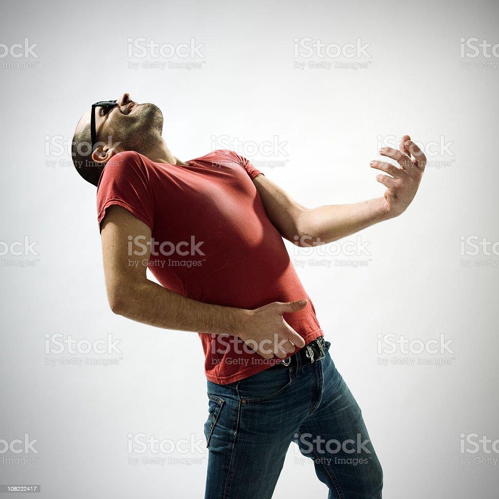 Young man playing air guitar stock photo