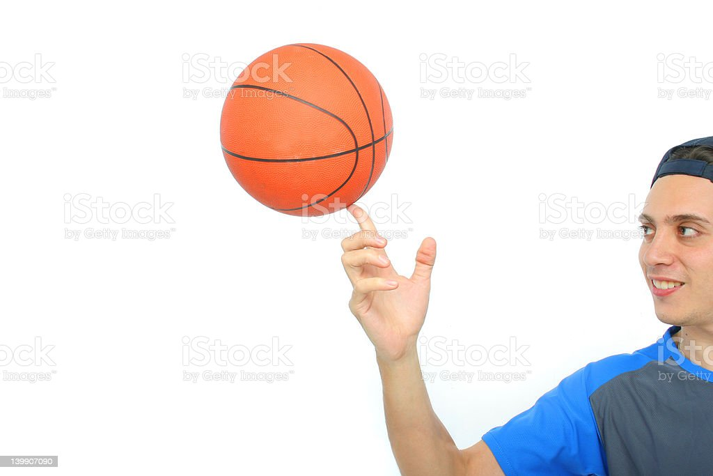 Young man playing basketball isolated royalty-free stock photo