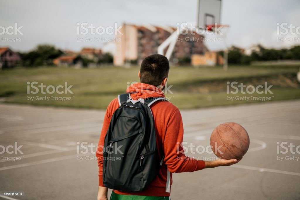 Young man playing basketball on his favorite court royalty-free stock photo