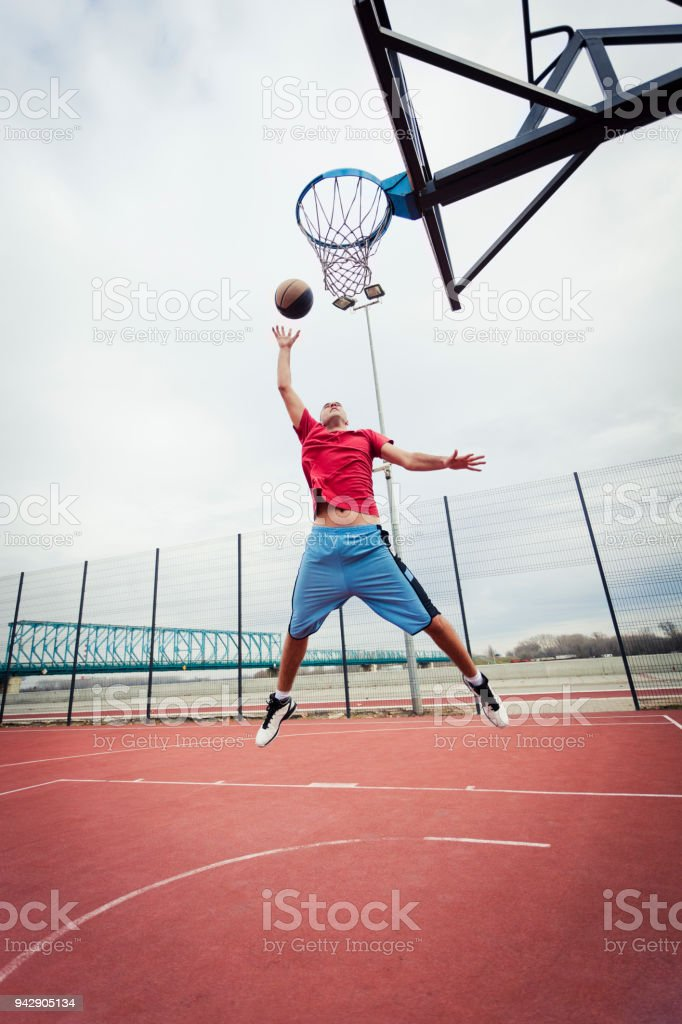Young man playing basketball stock photo