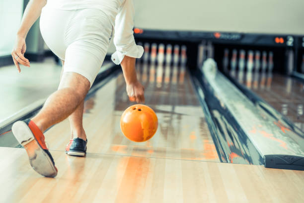 Young man playing bowling. stock photo