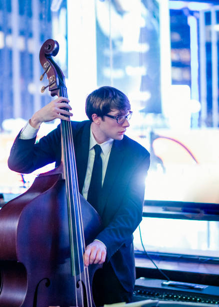 Young man playing contrabasson stock photo