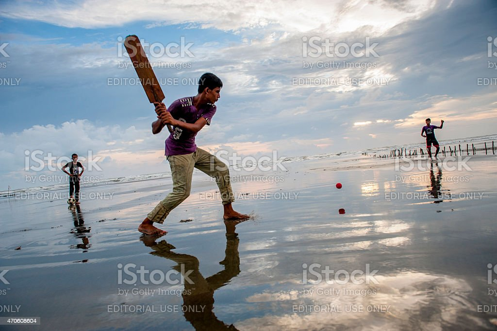 Young man playing crickets on the beach, Cox's Bazar, Bangladesh stock photo