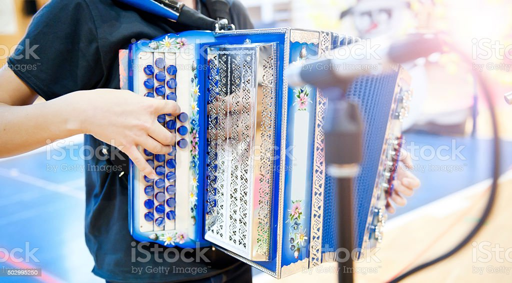 Young man playing diatonic accordion stock photo