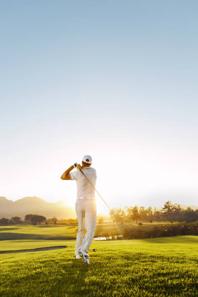 young man playing golf on a sunny day - golf stock photos and pictures