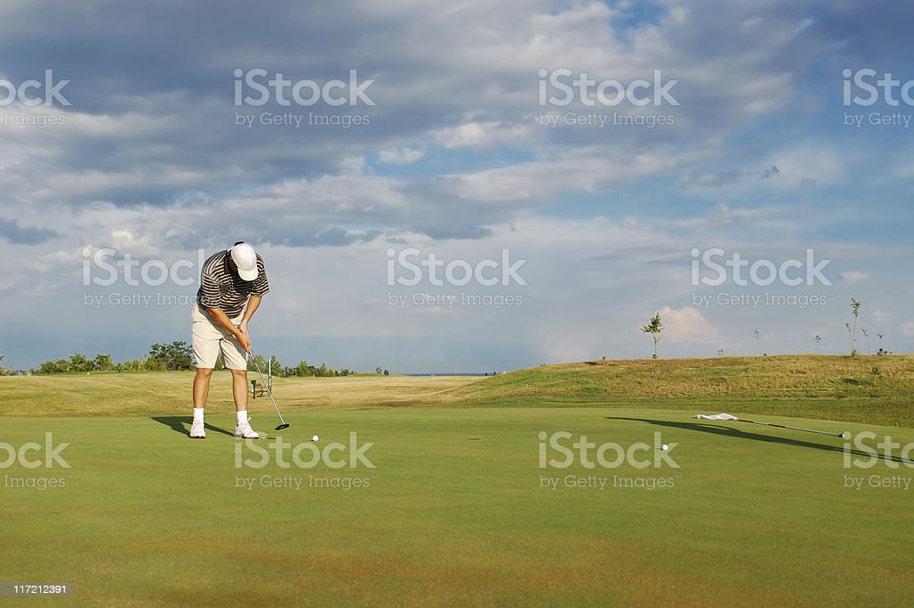 Young man playing golf royalty-free stock photo