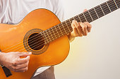 istock Young man playing guitar classic of relaxation music 1084545996