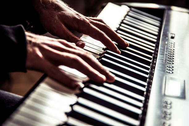 Young Man playing keyboard Young Man playing keyboard keyboard player stock pictures, royalty-free photos & images