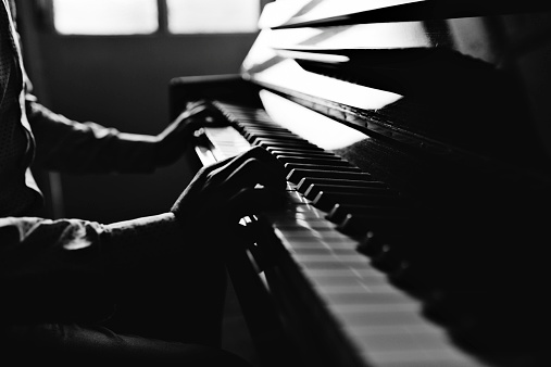 Young Man Playing Piano Stock Photo - Download Image Now