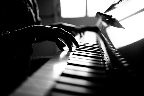 Young man playing piano