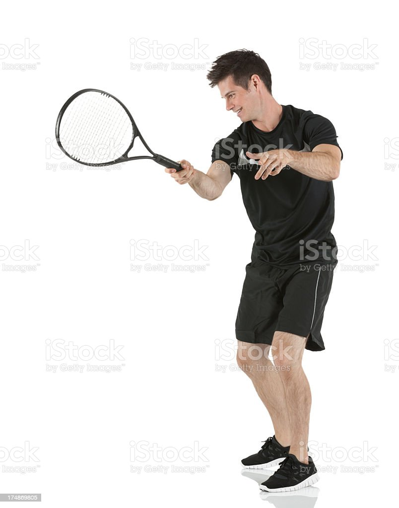 Young man playing tennis royalty-free stock photo
