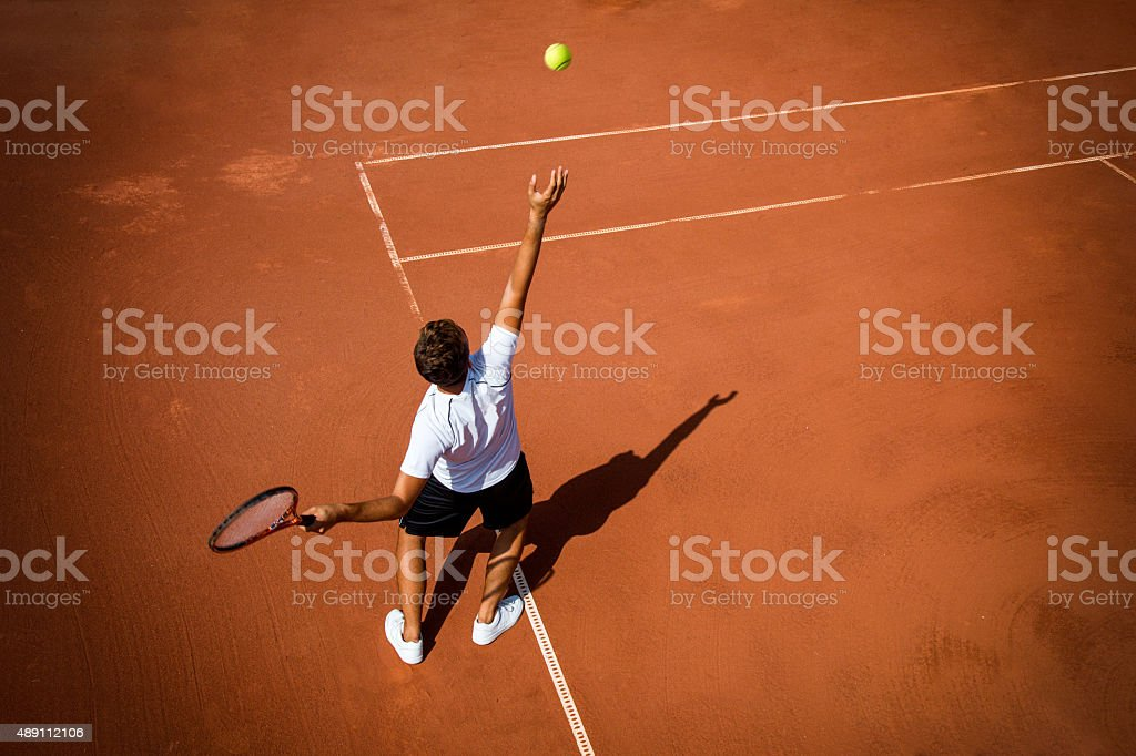 Young man playing tennis stock photo