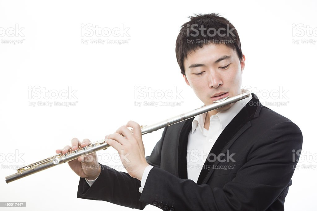 Young man Playing the flute stock photo