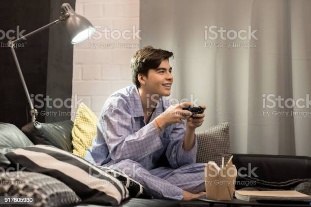 Young man playing video games picture id917805930?b=1&k=6&m=917805930&s=612x612&h=qswkh4gtleimmaa1jbymoa1priank2gc xjirgafo a=