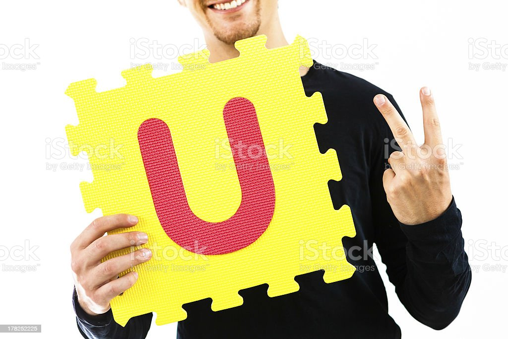 Young Man Playing with Alphabet Puzzle, For U stock photo