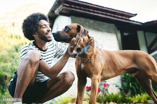 Man playing with her dog