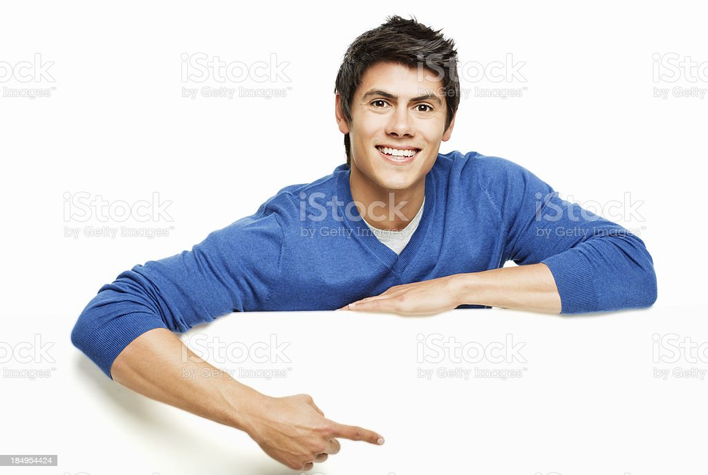 Young Man Pointing at a Blank Wall - Isolated royalty-free stock photo