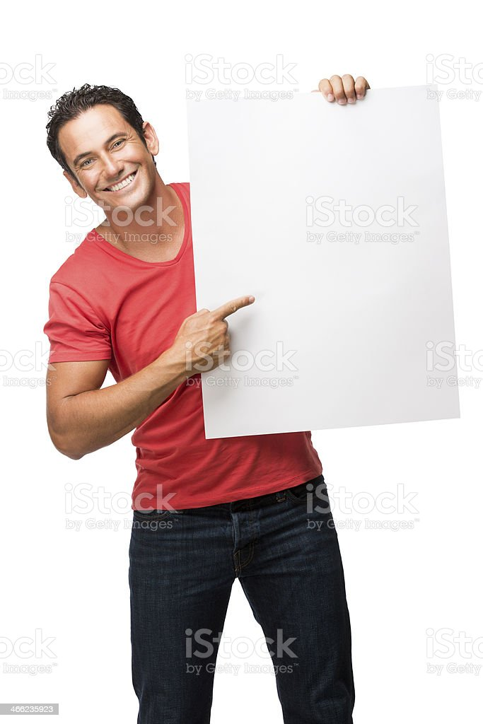Young man pointing at a sign royalty-free stock photo