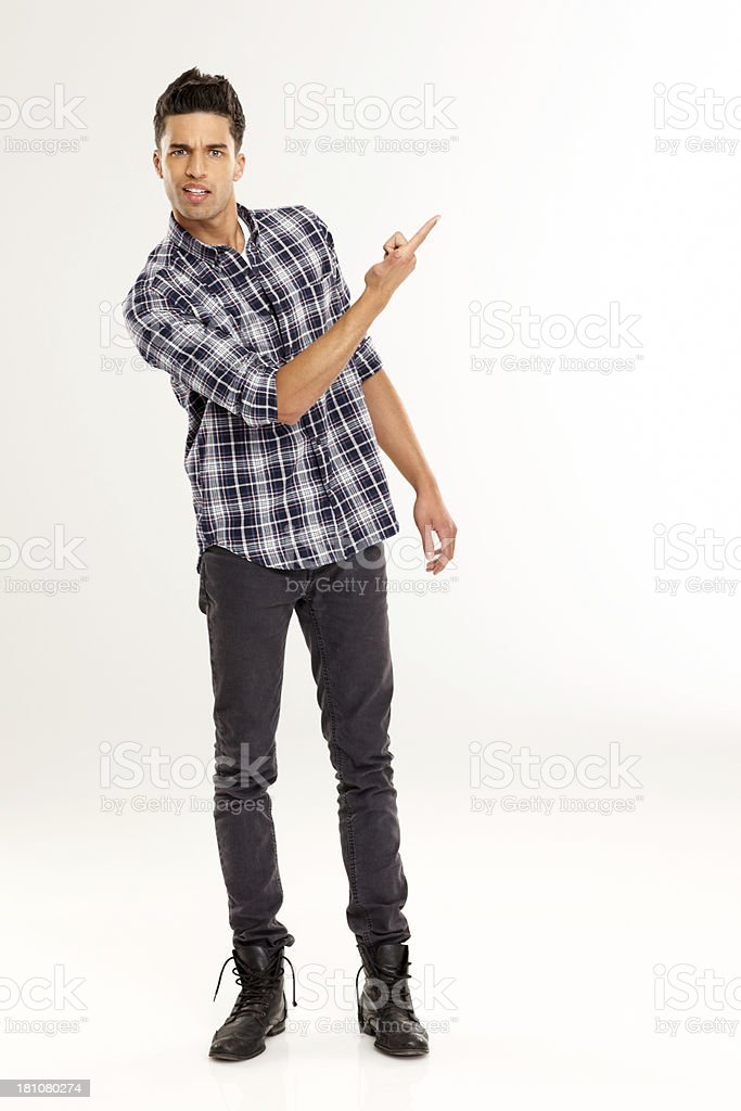 Young man pointing at copyspace over white royalty-free stock photo