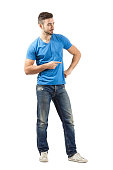 istock Young man pointing finger while flirting 526370319