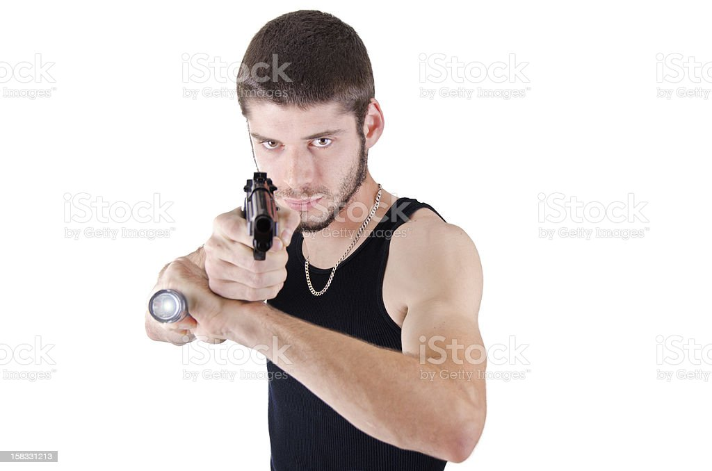 Young man pointing gun stock photo