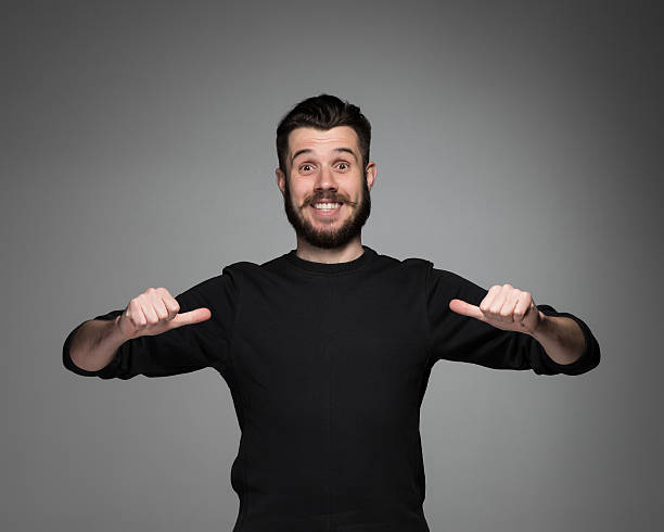 young man pointing himself stock photo