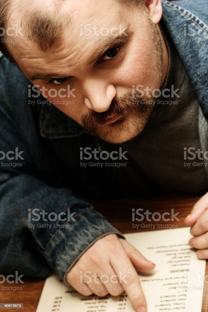 Young Man Pointing to a Menu royalty-free stock photo