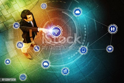 istock young man pointing to the air and Internet of Things concept 810397028